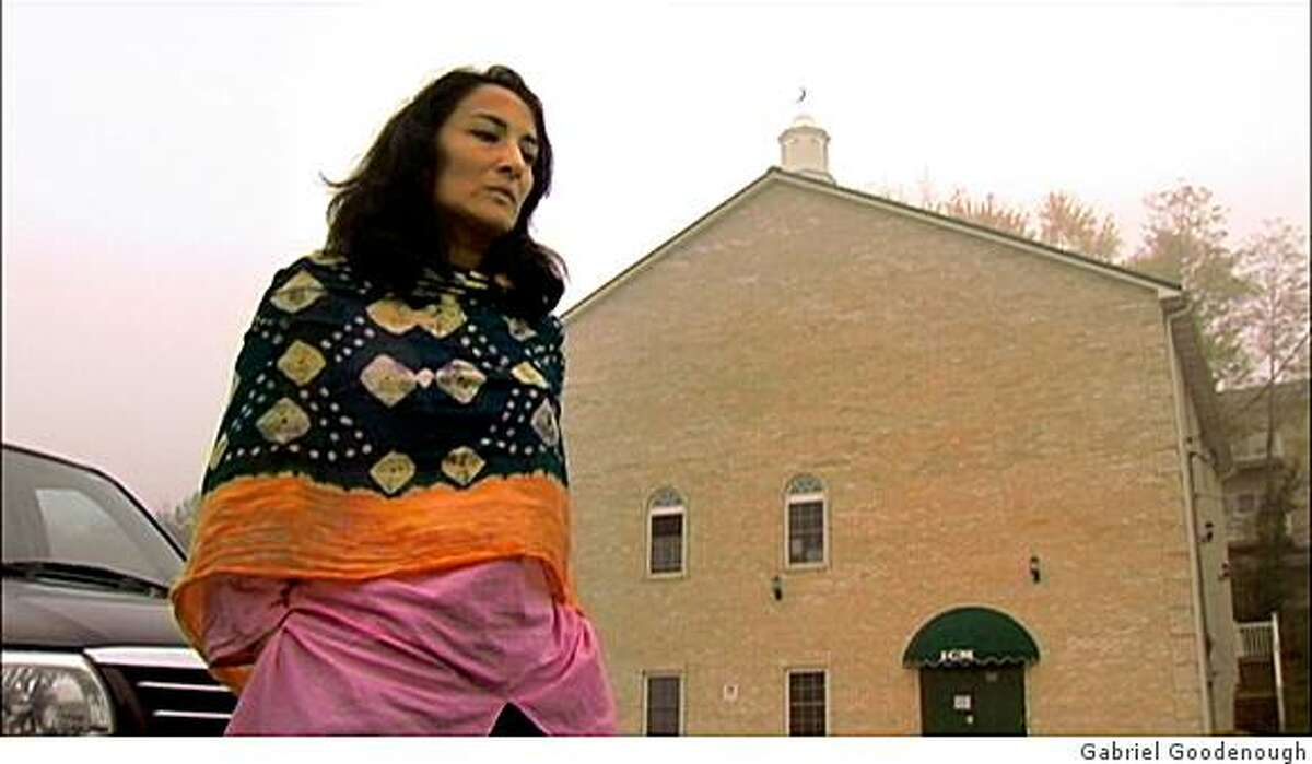 Asra Nomani, director of the Pearl Project at Georgetown University, stands before her hometown mosque in Morgantown, W. Va. From the PBS documentary,