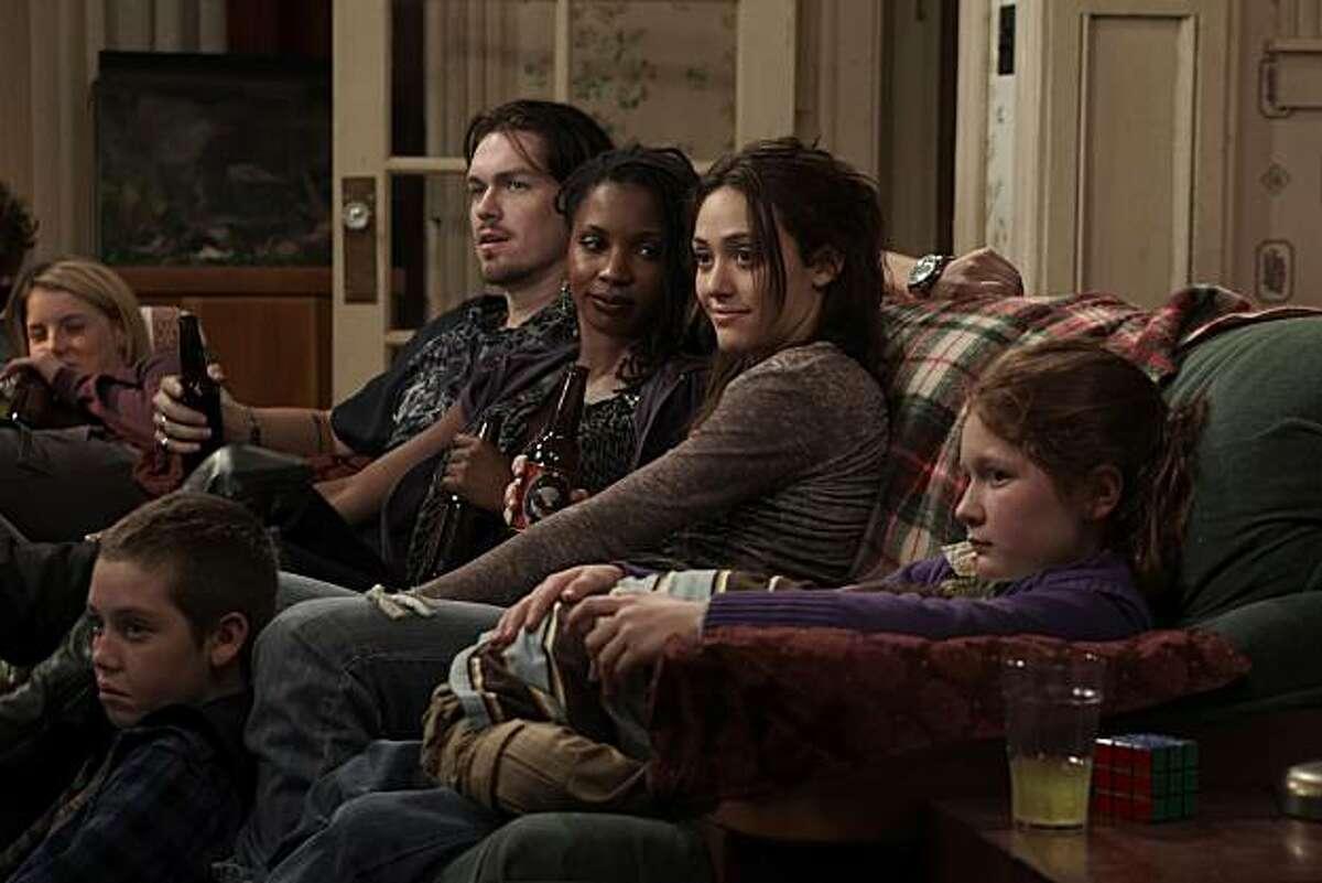 Laura Slade Wiggins as Karen, Ethan Cutkosky as Carl, Steve Howey as Kev, Shanola Hampton as Veronica, Emmy Rossum as Fiona Gallagher, and Emma Kenney as Debbie in Shameless