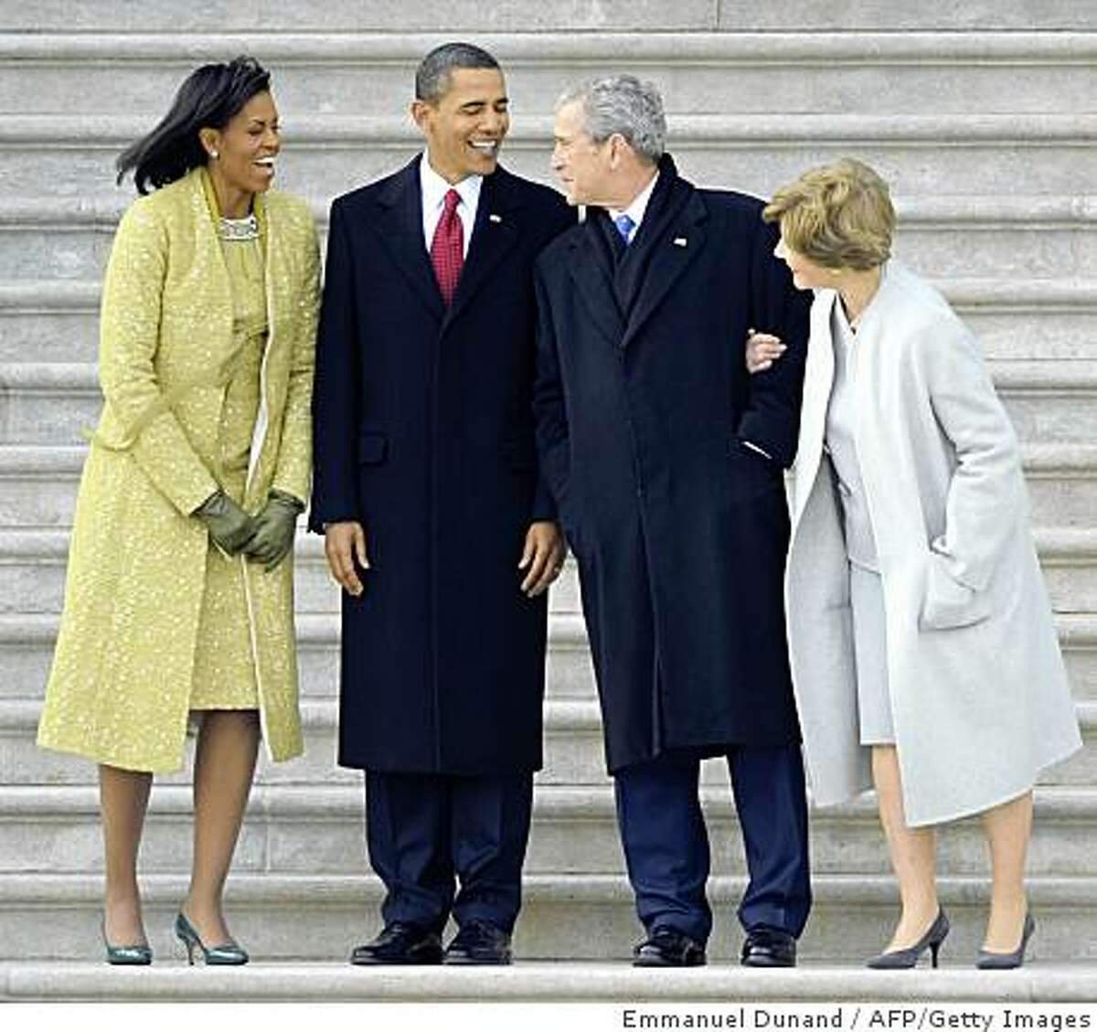 US Presisdent Barack Obama (2nd L), First Lady Michelle Obama (L), former president George W. Bush (2nd R) and former first lady Laura Bush chat on the steps of the Capitol after Obama's Obama's inauguration in Washington on January 20, 2009. AFP PHOTO/Emmanuel Dunand (Photo credit should read EMMANUEL DUNAND/AFP/Getty Images)