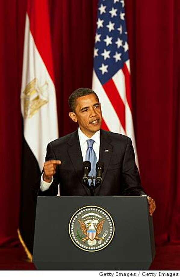 "CAIRO, EGYPT - JUNE 4:  U.S. President Barack Obama makes his key Middle East speech at  Cairo University June 4, 2009 in Cairo, Egypt. In his speech, President Obama called for a ""new beginning between the United States and Muslims"", declaring that ""this cycle of suspicion and discord must end"".  (Photo by Getty Images) Photo: Getty Images"