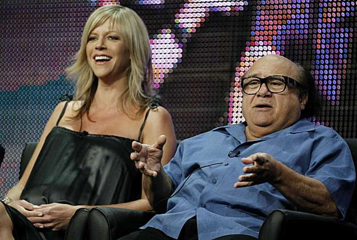 Actors Danny DeVito, right, and Kaitlin Olson, from