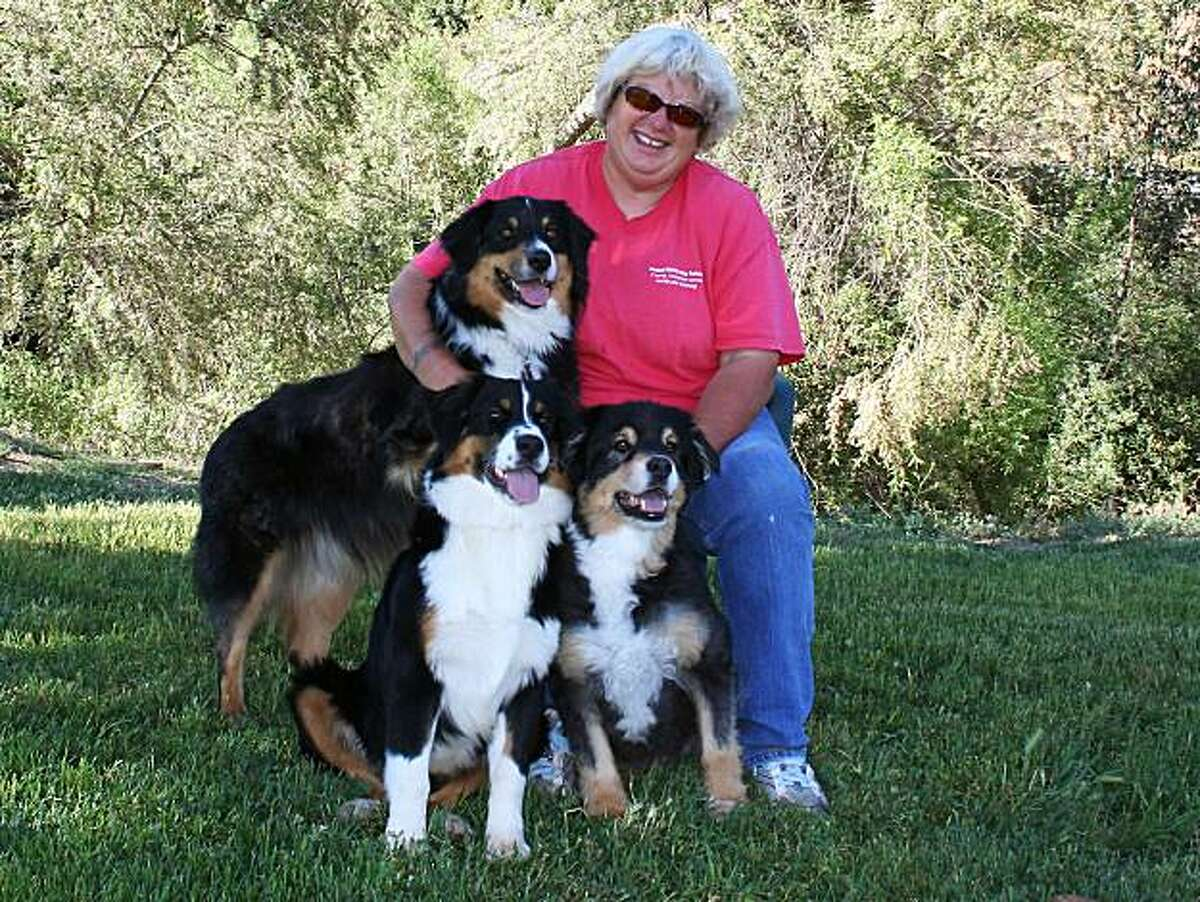 Dog trainer Liz Palika teaches dog owners how to read their dogs' movements and other signs that reveal a canine's mood.