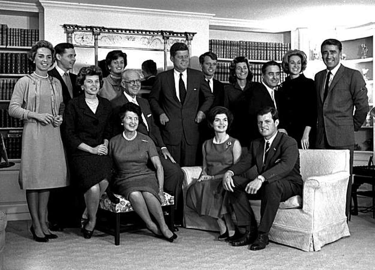 FILE - In this Nov. 9, 1960 file photo, President-elect John F. Kennedy, center, is surrounded by members of his family in the living room of the home of Joseph P. Kennedy, in Hyannisport, Mass. Standing, from left, Ethel Kennedy; Steve Smith and wife, Jean Kennedy; Senator Kennedy; brother Robert, campaign manager; sister, Patricia Lawford; Sargent Shriver; brother Ted's wife, Joan; and British actor Peter Lawford. In foreground, seated from are: Eunice Shriver, sister; mother Rose Kennedy; father, Joseph; Jacqueline Kennedy, wife of John; and Ted Kennedy, brother of the president-elect. (AP Photo, file)