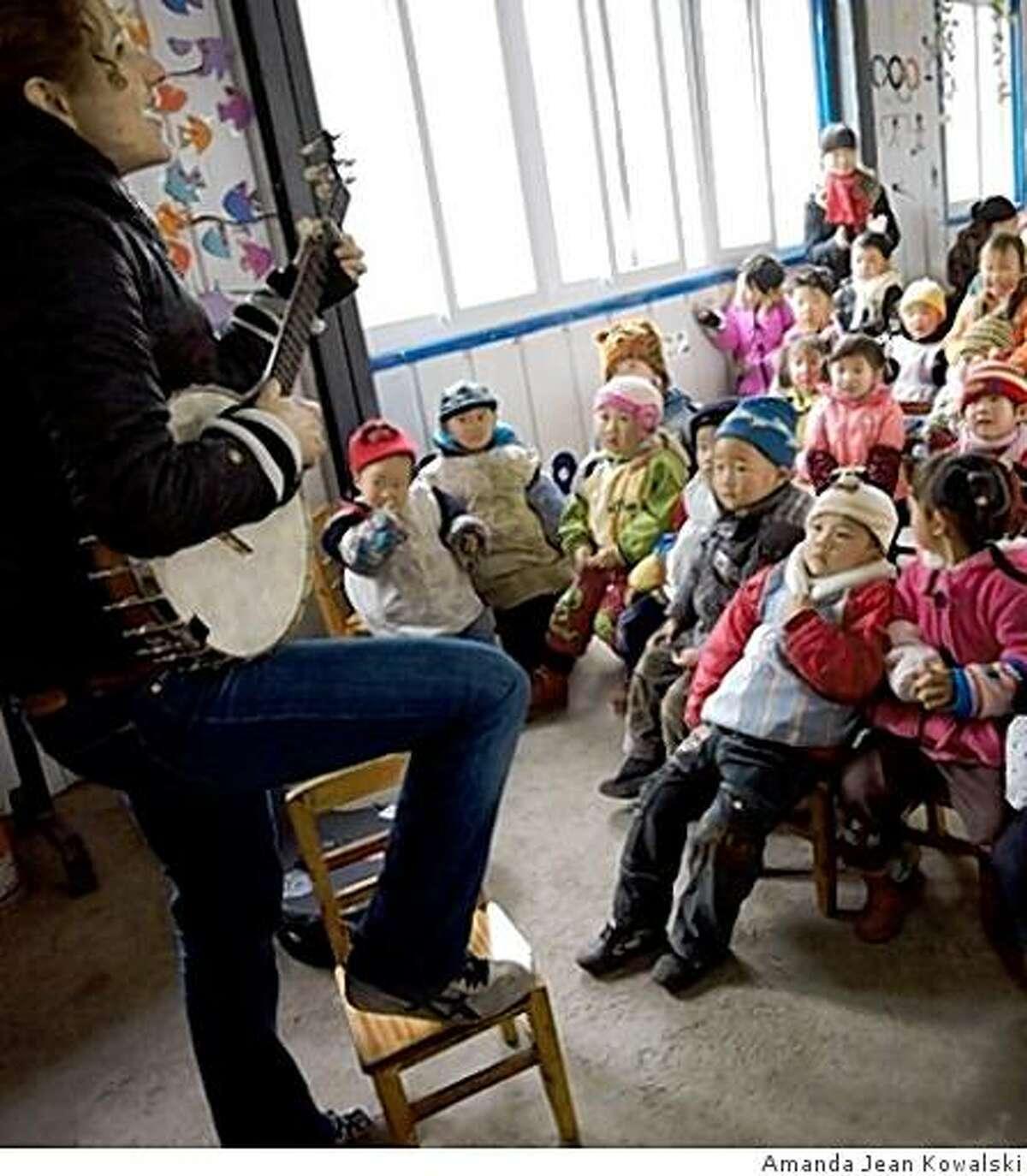 Abigail Washburn, performing for a Sichuan elementary school class.