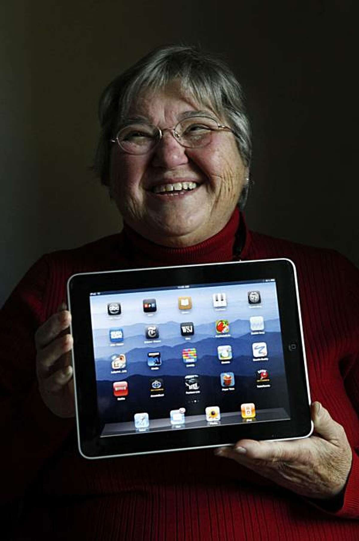 Rita Schena, 78, sits for a portrait with her new iPad at home on Thursday April 29, 2010 in Menlo Park, Calif. Schena said she is very excited to have this device and feels its perfect for seniors on the go.
