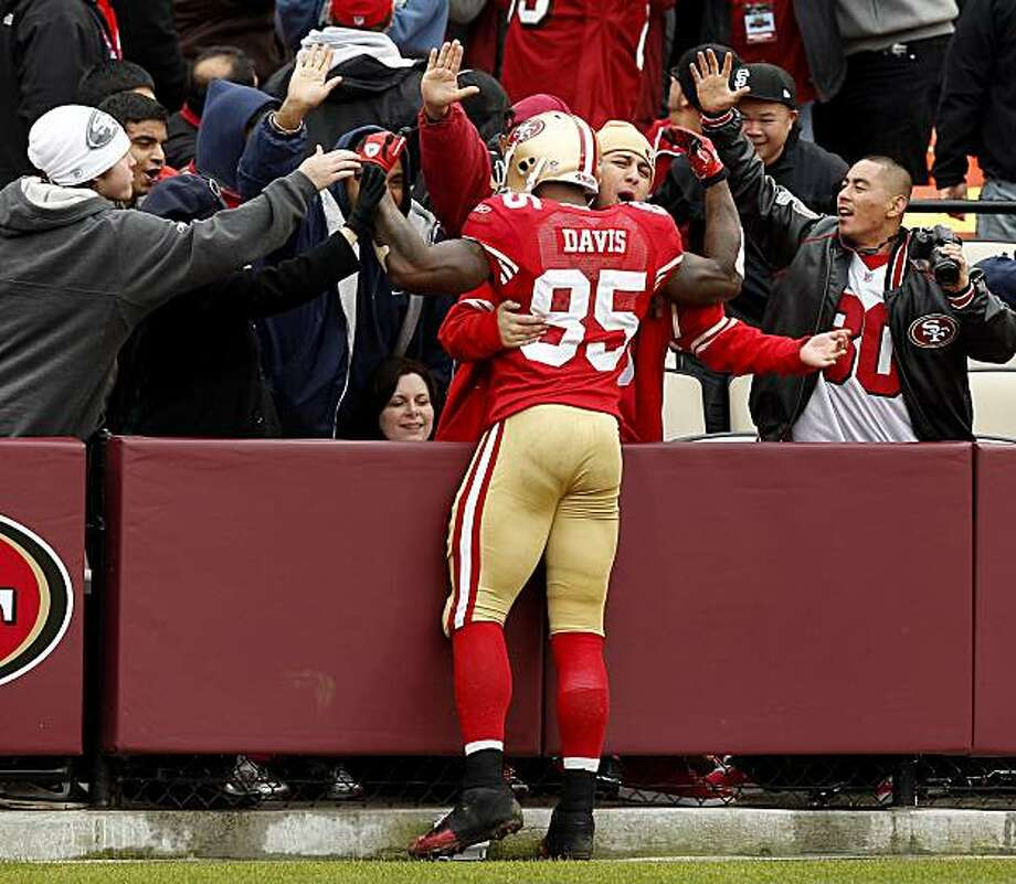Vernon Davis is congratulated by fans in the endzone after his third quarter touchdown in the last game of the regular season at Candlestick Park on Sunday. Photo: Brant Ward, The Chronicle