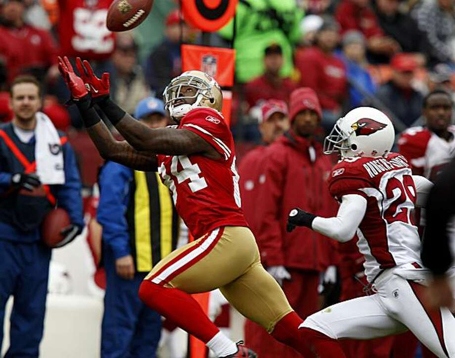 Josh Morgan catches a pass for a big gain in the first half of the last game of the 2011 regular season at Candlestick Park. Photo: Brant Ward, The Chronicle