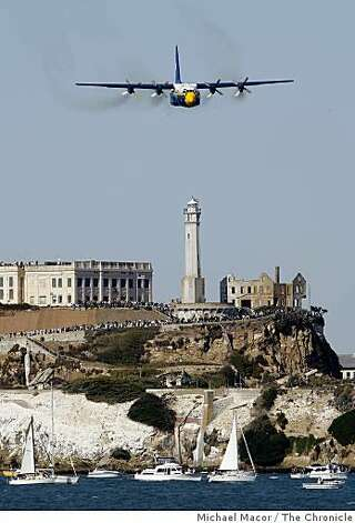 The Navy Blue Angels' C-130 aircraft flies low over Alcatraz. Photo: Michael Macor, The Chronicle