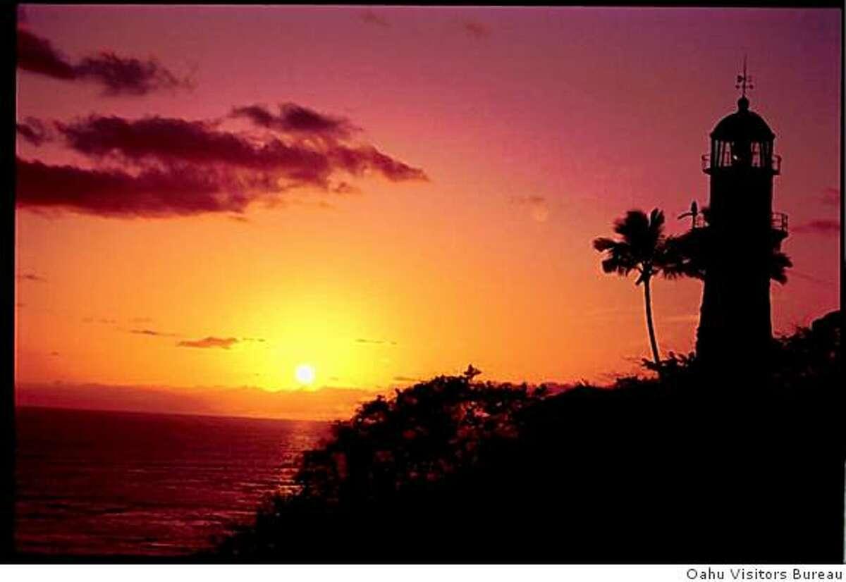 Sunset illuminates Diamond Head Lighthouse.