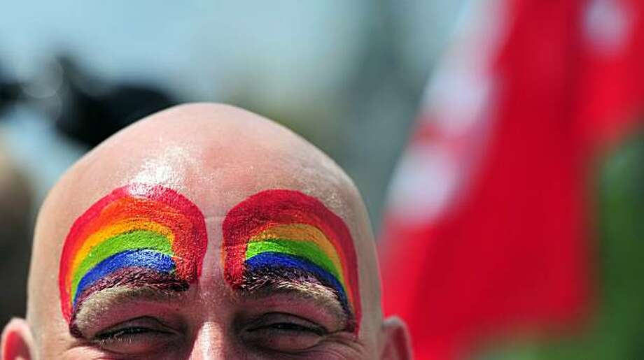 A participant of the Christopher Street Day (CSD) gay pride parade looks on in Berlin on June 19, 2010. Gays and lesbians around the world celebrate the Christopher Street Day (CSD) gay and lesbian pride parade, arguably the most important date in their calendar. Photo: Johannes Eisele, AFP/Getty Images