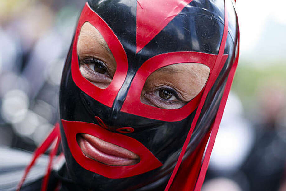 A woman with a mask attends the Christopher Street Day parade in Berlin, on Saturday, June 19, 2010. Photo: Markus Schreiber, AP