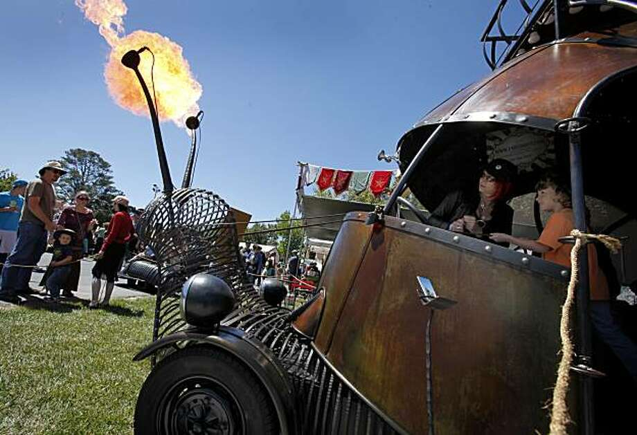 The familiar snailcart got attention when flames flew from the antennae at the annual Maker Faire, a spectacle of ingenious inventions and gadgets Sunday at the San Mateo County Event Center. Photo: Brant Ward, The Chronicle