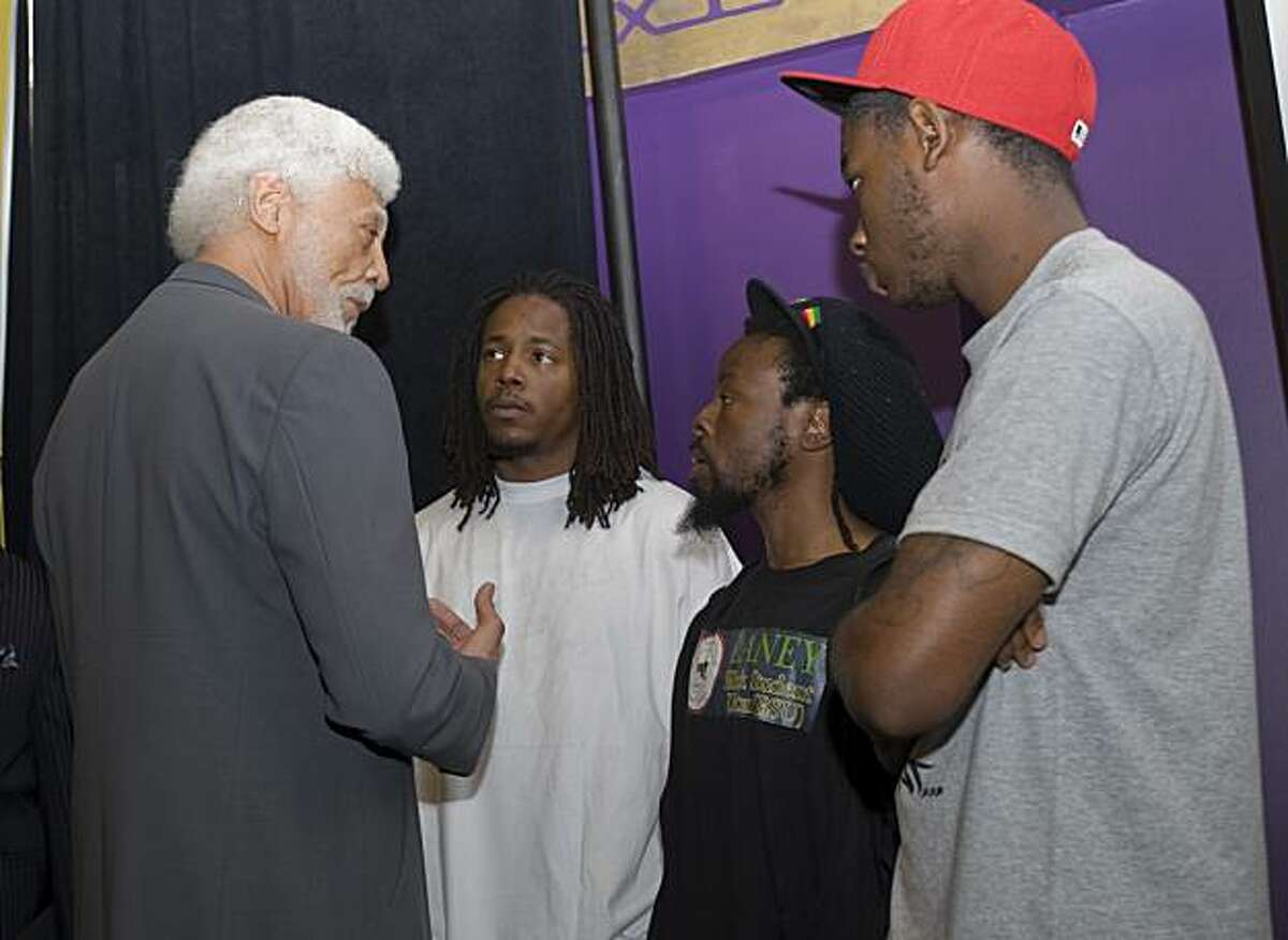 Oakland mayor Ron Dellums (left) speaks with members of the Laney College Black Student Union Michael Walker, Jabari Shaw and Jevon Cochrane (from left to right) press conference on Friday, July 2, 2010 in Oakland, Calif., to urge the public to refrain from violence when the Mehserle verdict is revealed in Los Angeles.
