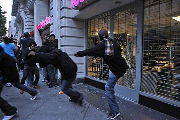People react to the former BART police officer Johannes Mehserle being found guilty of involuntary manslaughter in the shooting death of Oscar Grant,by kicking in the window of the Footlocker on Broadway,  Thursday July 8, 2010, in Oakland, Calif.  Calif. Photo: Lacy Atkins, The Chronicle