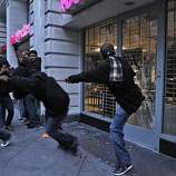 People react to the former BART police officer Johannes Mehserle being found guilty of involuntary manslaughter in the shooting death of Oscar Grant,by kicking in the window of the Footlocker on Broadway,  Thursday July 8, 2010, in Oakland, Calif.  Calif.