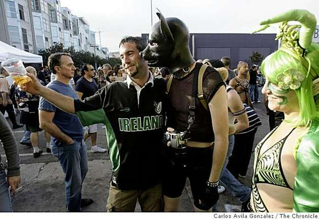 Wayne Cleurkin, left, poses with dougie puppy and the Tentacle Rape Fairy, at the Folsom Street Fair. Thousands attended the 25th anniversary Folsom Street Fair in San Francisco, Calif., on Sunday, September 28, 2008. Photo: Carlos Avila Gonzalez, The Chronicle
