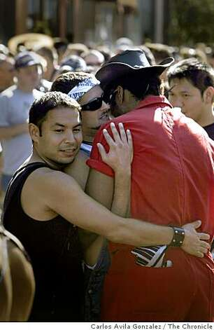 Phenizee McElroy, right, hugs, Sven Orozco, left, and Judd Singleton, center at the Folsom Street Fair. Thousands attended the 25th anniversary Folsom Street Fair in San Francisco, Calif., on Sunday, September 28, 2008. Photo: Carlos Avila Gonzalez, The Chronicle