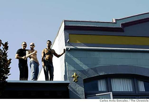 Festivalgoers watch the happenings at the Folsom Street Fair from a rooftop. Thousands attended the 25th anniversary Folsom Street Fair in San Francisco, Calif., on Sunday, September 28, 2008. Photo: Carlos Avila Gonzalez, The Chronicle