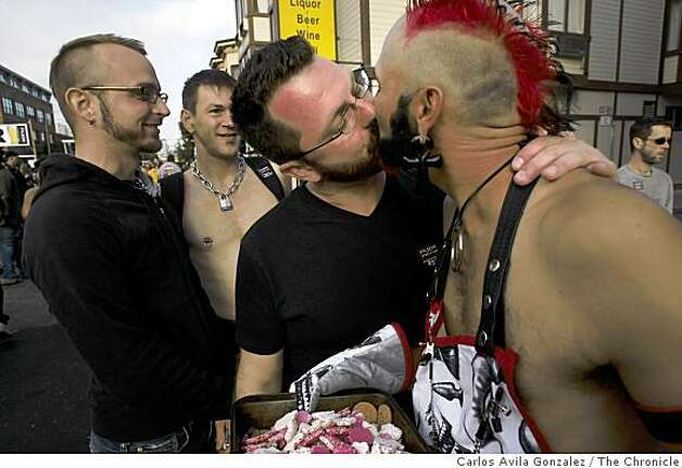Joshua Love, center, kisses, Shade, right, at the Folsom Street Fair. Thousands attended the 25th anniversary Folsom Street Fair in San Francisco, Calif., on Sunday, September 28, 2008. Photo: Carlos Avila Gonzalez, The Chronicle