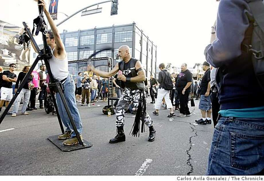 Ben Kaufman, is whipped by Taino at the Mr. S. Leather Booth. Thousands attended the 25th anniversary Folsom Street Fair in San Francisco, Calif., on Sunday, September 28, 2008. Photo: Carlos Avila Gonzalez, The Chronicle