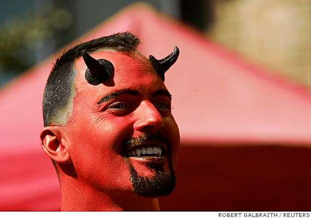 A man in a devil's costume walks along Folsom Street during the 25th Folsom Street Fair, a leather and fetish event, in San Francisco. Photo: ROBERT GALBRAITH, REUTERS