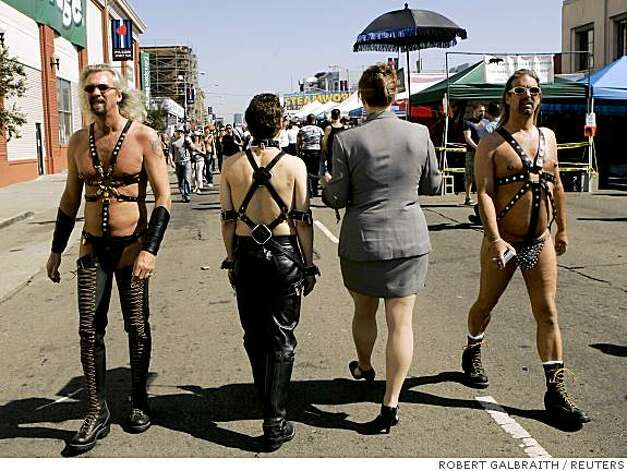 People wearing leather walk along Folsom Street during the 25th Folsom Street Fair, a leather and fetish event, in San Francisco. Photo: ROBERT GALBRAITH, REUTERS
