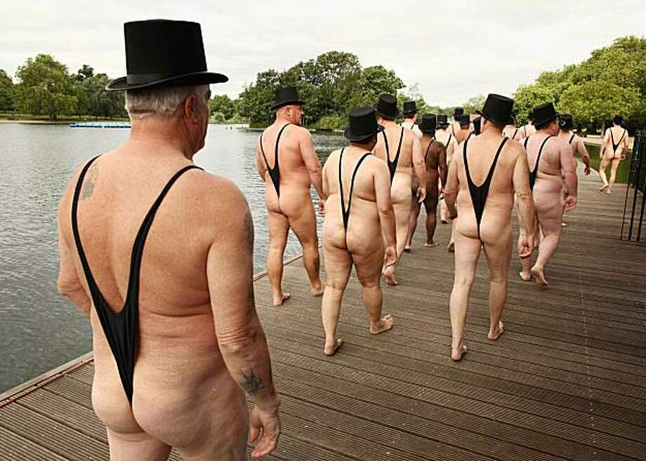 Men dressed as 'greedy businessmen' walk next to the Serpentine Lake in Hyde Park for a mobile phone promotion on June 16, 2010 in London, England. Giffgaff promotes it's new mobile phone tarrif as 'community-led'. Photo: Peter Macdiarmid, Getty Images
