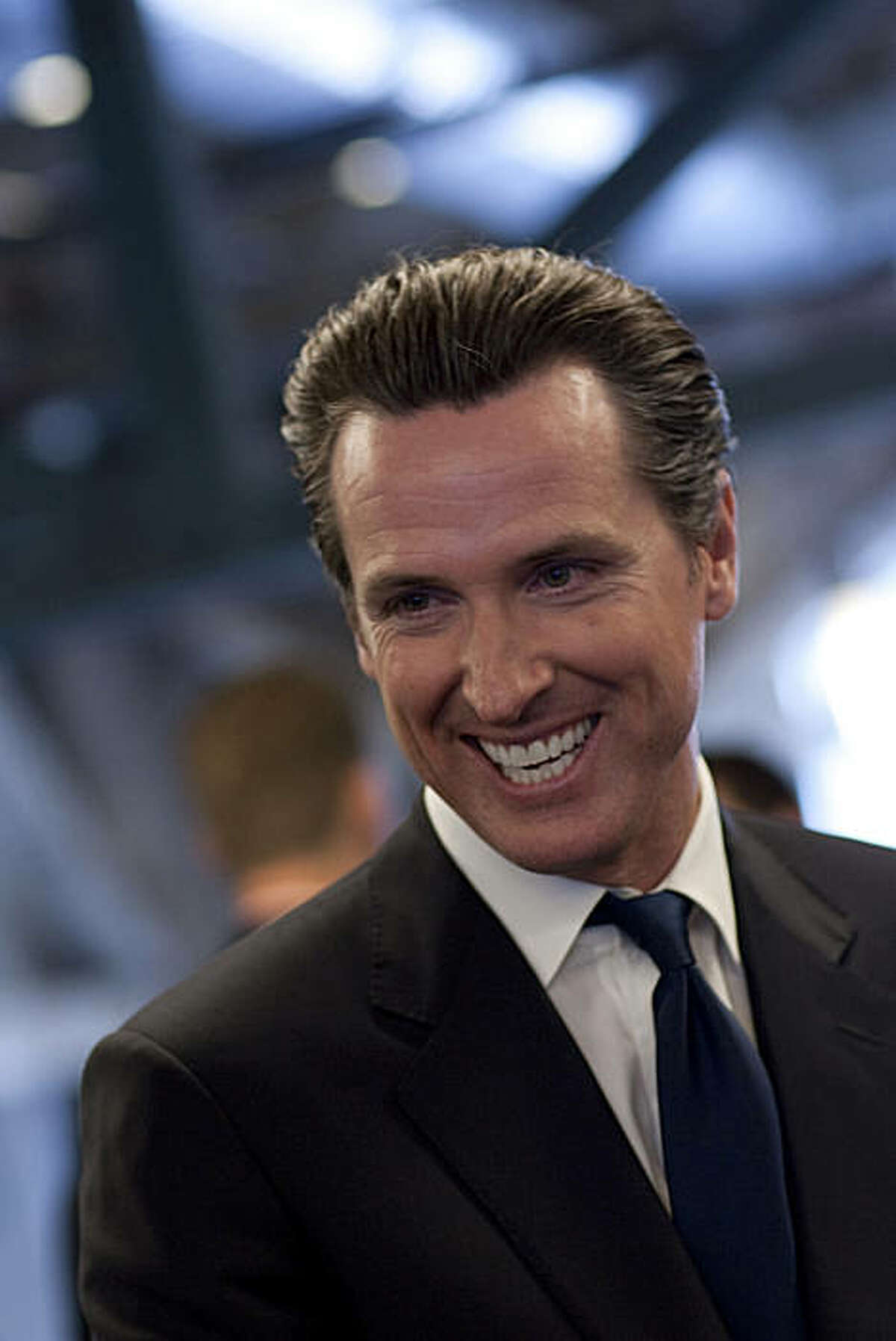 San Francisco Mayor Gavin Newsom laughs during the launch party celebrating the joining of Bloomberg News and the San Francisco Chronicle to produce a new daily business section in the Chronicle at Bloomberg's San Francisco bureau on June 22, 2010 in San Francisco, California. The collaboration, which will be named Business Report, The Chronicle with Bloomberg, will feature stories produced by both the Chronicle staff and Bloomberg News and is the first of it's kind in the United States. Photograph by David Paul Morris/Special to the Chronicle