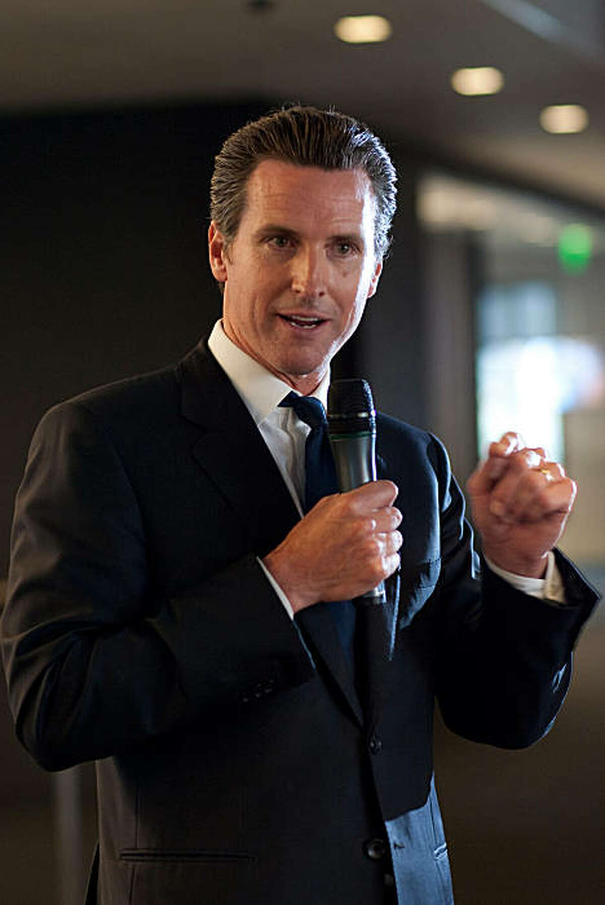 San Francisco Mayor Gavin Newsom speaks to people during the launch party celebrating the joining of Bloomberg News and the San Francisco Chronicle to produce a new daily business section in the Chronicle at Bloomberg's San Francisco bureau on June 22, 2010 in San Francisco, California. The collaboration, which will be named Business Report, The Chronicle with Bloomberg, will feature stories produced by both the Chronicle staff and Bloomberg News and is the first of it's kind in the United States. Photograph by David Paul Morris/Special to the Chronicle