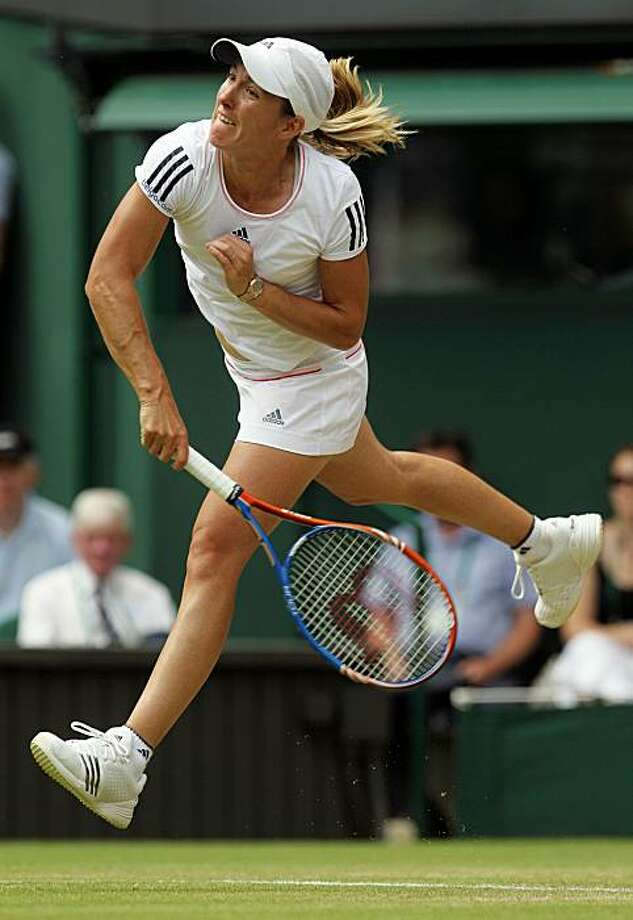 LONDON, ENGLAND - JUNE 25:  Justine Henin of Belgium in action during her match against Nadia Petrova of Russia on Day Five of the Wimbledon Lawn Tennis Championships at the All England Lawn Tennis and Croquet Club on June 25, 2010 in London, England. Photo: Hamish Blair, Getty Images