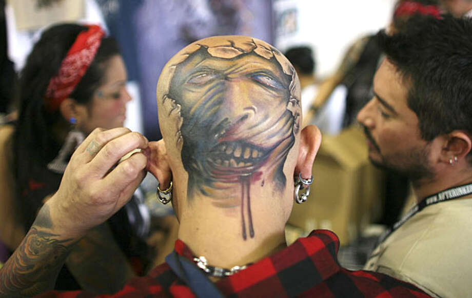 A tattoo is seen on the back of a man's head during the IV International Tattoo Artist Convention in Bogota, Sunday, June 6, 2010. Photo: William Fernando Martinez, AP