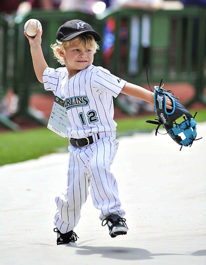 Three year old Hudson Ross, son of Florida Marlins baseball player Cody Ross, winds up to throw as he has a catch with his father during batting practice before the game against the New York Mets Saturday, June 5, 2010, in New York. Photo: Kathy Kmonicek, AP