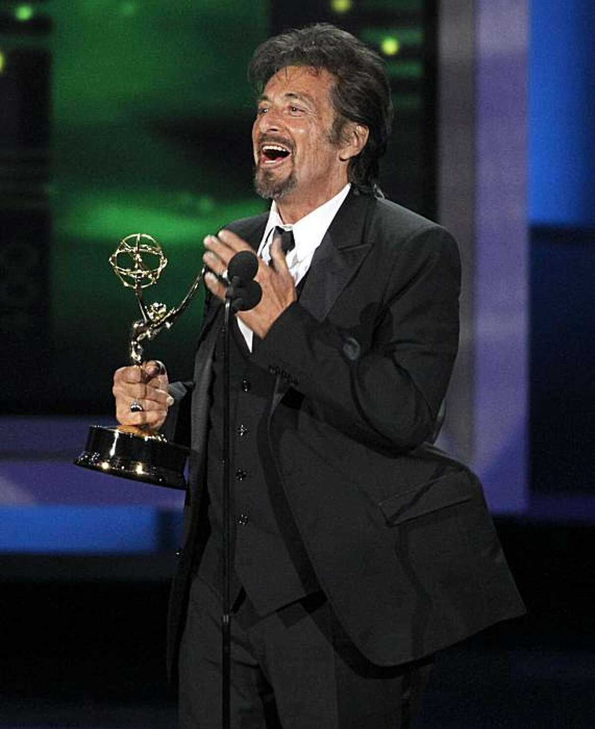 Al Pacino acknowledges Dr. Jack Kevorkian as he accepts the award for outstanding lead actor in a miniseries or movie during the 62nd Primetime Emmy Awards Sunday, Aug. 29, 2010, in Los Angeles.