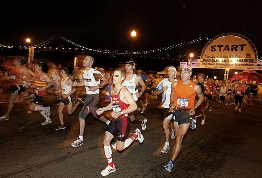 And they're off! The first elite runners began the 26.2 mile run. The annual San Francisco Marathon started at 5:30 am Sunday and attracted more than 25,000 runners on a cool, foggy summer morning. Photo: Brant Ward, The Chronicle