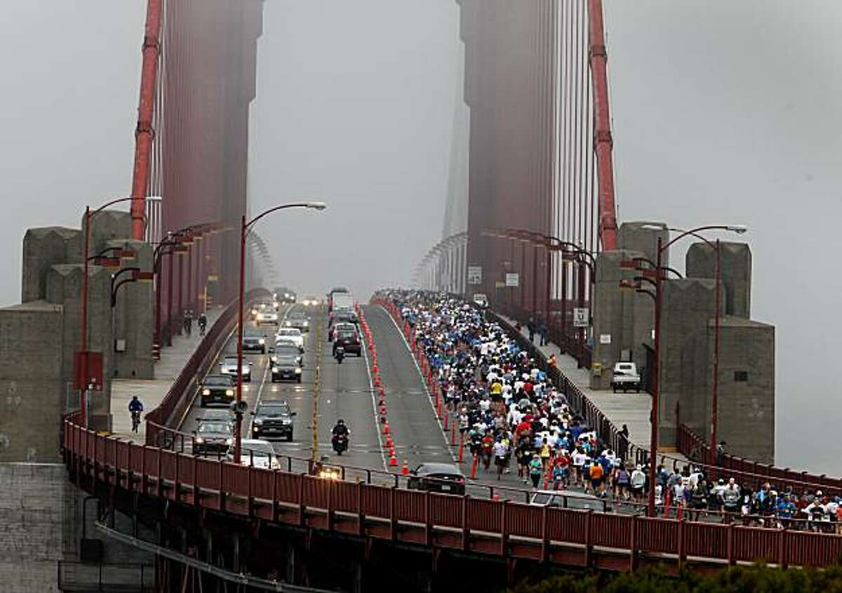Runners crowded into the northbound lanes of the Golden Gate Bridge which they shared with regular Sunday morning traffic.The annual San Francisco Marathon started at 5:30 am Sunday July 25, 2010 and attracted over 25,000 runners on a cool, foggy summer morning.