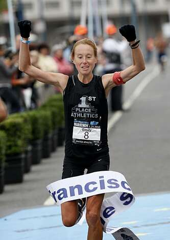 Emily Hardin from Alabama was the first woman marathon finisher. The annual San Francisco Marathon started at 5:30 am Sunday July 25, 2010 and attracted over 25,000 runners on a cool, foggy summer morning. Photo: Brant Ward, The Chronicle