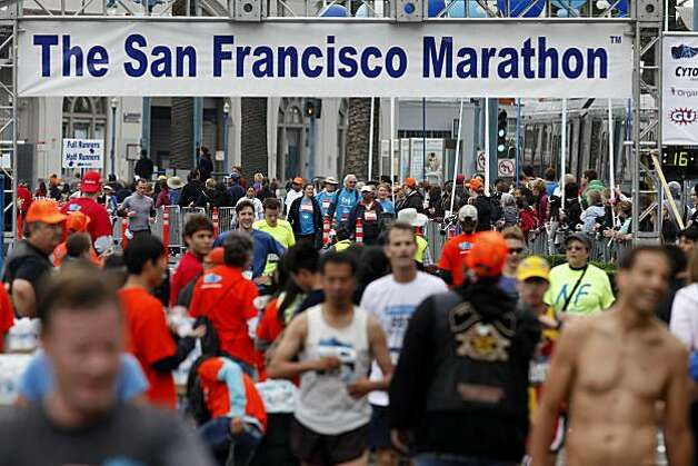 The finish line was right next to Folsom Street on the Embarcadero. The annual San Francisco Marathon started at 5:30 am Sunday July 25, 2010 and attracted over 25,000 runners on a cool, foggy summer morning. Photo: Brant Ward, The Chronicle