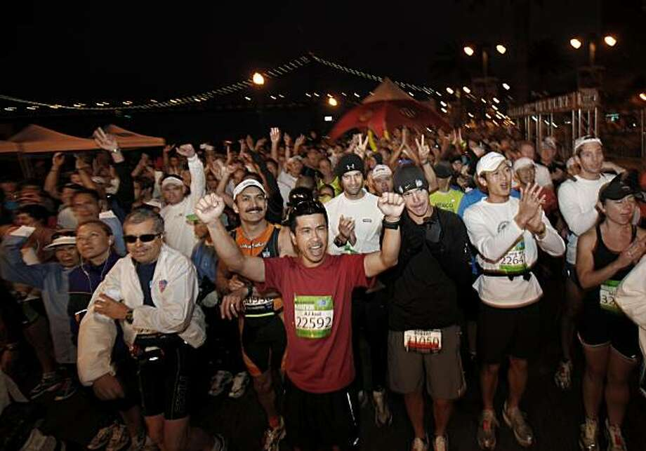 A group of marathoners got enthusiastic as the starting time got closer. The annual San Francisco Marathon started at 5:30 am Sunday July 25, 2010 and attracted over 25,000 runners on a cool, foggy summer morning. Photo: Brant Ward, The Chronicle
