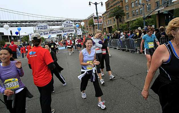 Some progressive marathoners and 5K runners proceeded past the finish line. The annual San Francisco Marathon started at 5:30 am Sunday July 25, 2010 and attracted over 25,000 runners on a cool, foggy summer morning. Photo: Brant Ward, The Chronicle