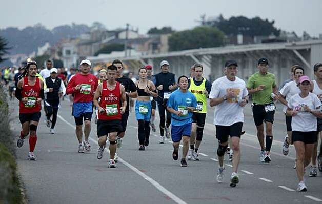 Runners ran alongside Crissy Field as they made their way towards the Golden Gate Bridge. The annual San Francisco Marathon started at 5:30 am Sunday July 25, 2010 and attracted over 25,000 runners on a cool, foggy summer morning. Photo: Brant Ward, The Chronicle