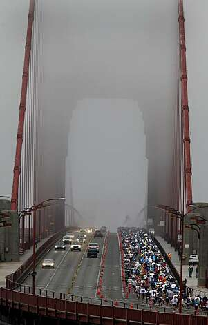 There was not much of a view from the foggy Golden Gate Bridge but runners appreciated the foggy conditions. The annual San Francisco Marathon started at 5:30 am Sunday July 25, 2010 and attracted over 25,000 runners on a cool, foggy summer morning. Photo: Brant Ward, The Chronicle