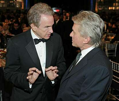 CULVER CITY, CA - JUNE 10:  Acors Warren Beatty (L) and Michael Douglas in the audience during the 38th AFI Life Achievement Award honoring Mike Nichols held at Sony Pictures Studios on June 10, 2010 in Culver City, California. The AFI Life Achievement Award tribute to Mike Nichols will premiere on TV Land on Saturday, June 25 at 9PM ET/PST.  (Photo by Frazer Harrison/Getty Images for AFI) Photo: Frazer Harrison, Getty Images For AFI