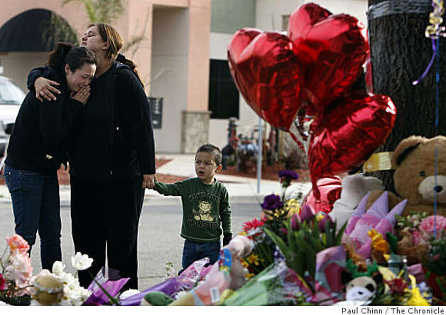 Nichole Lee (left) is comforted by Manuela Zaragosa and her son Freddy at a memorial arranged for Sandra Cantu at the entrance to the Orchard Estates mobile home park in Tracy, Calif., on Tuesday, April 7, 2009. Lee would occasionally baby sit for the eight-year-old, who's body was discovered in a large suitcase by farm workers draining an irrigation ditch Monday. Photo: Paul Chinn, The Chronicle