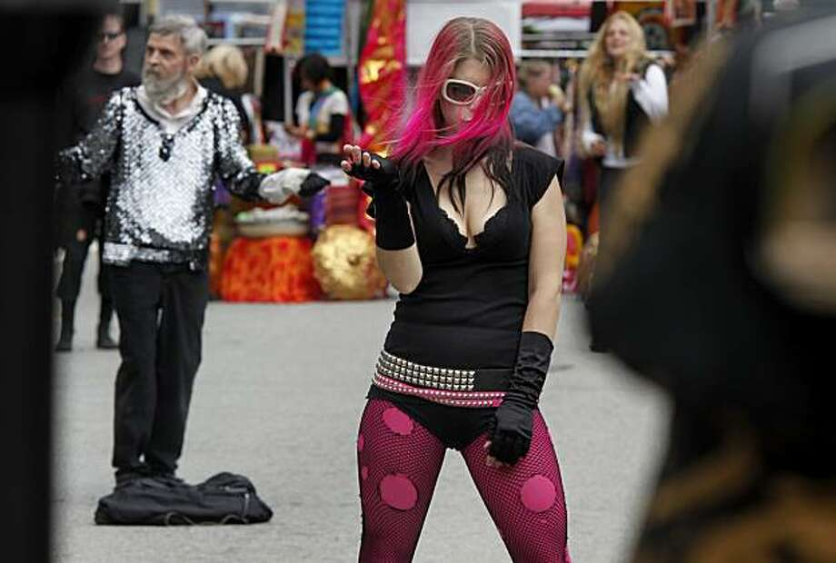 Trixxie Carr (center) enjoys the electronic music at the Symbiosis Stage at the 11th annual How Weird Street Faire in San Francisco on Sunday. Photo: Brant Ward, The Chronicle