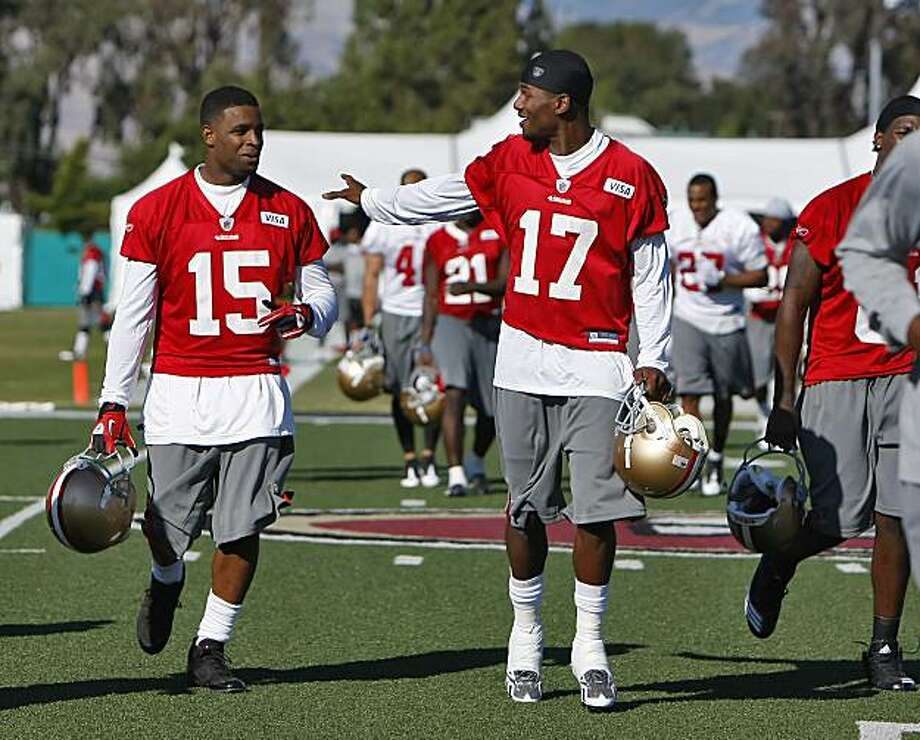 San Francisco 49ers Michael Crabtree, left  and Dominique Zeigler laugh as the head off the field after their first practice, Sunday Aug. 1, 2010, in Santa Clara, Calif. Photo: Lacy Atkins, The Chronicle