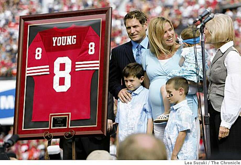 Steve Young (upper left) stands with his family next to a framed jersey with his number during a halftime ceremony retiring his jersey number on Sunday, October 5, 2008 in San Francisco, Calif. Photo: Lea Suzuki, The Chronicle