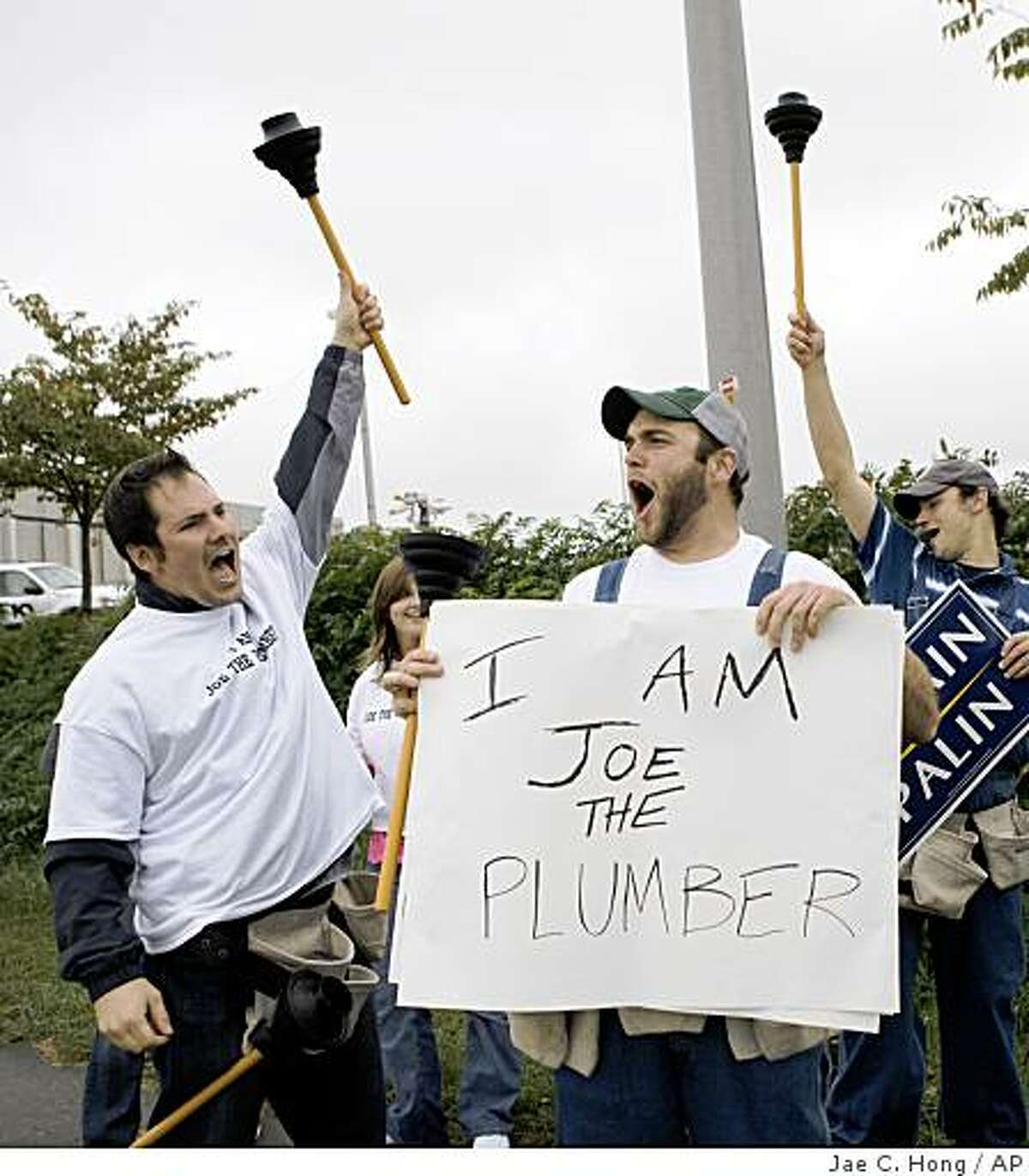 Supporters of Republican presidential candidate Sen. John McCain, R-Ariz., are dressed as Joe the Plumber as they stand outside the Roanoke Civic Center where a rally for Democratic presidential candidate, Sen. Barack Obama, D-Ill., takes place in Roanoke, Va., Friday, Oct. 17, 2008. (AP Photo/Jae C. Hong)