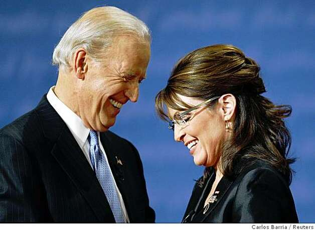 Democratic vice presidential nominee Senator Joe Biden (D-DE) (L) and Republican vice presidential nominee Alaska Governor Sarah Palin (R) smile as they chat onstage at the end of their vice presidential debate at Washington University in St. Louis, Missouri, October 2, 2008. Photo: Carlos Barria, Reuters