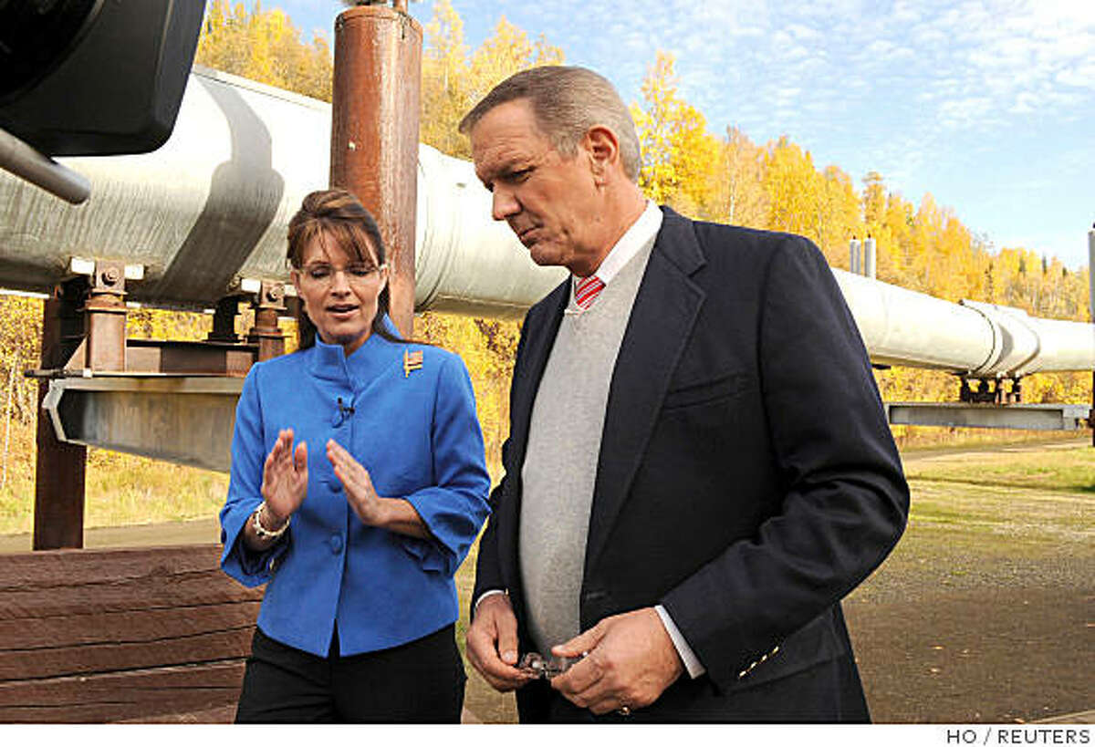 Republican vice presidential nominee Alaska Governor Sarah Palin (L) talks to Charles Gibson while walking alongside the Trans-Alaska Pipeline during an interview in Fairbanks, Alaska September 11, 2008. As governor of Alaska, she raised taxes on oil companies and clashed with them over a planned pipeline through her state.