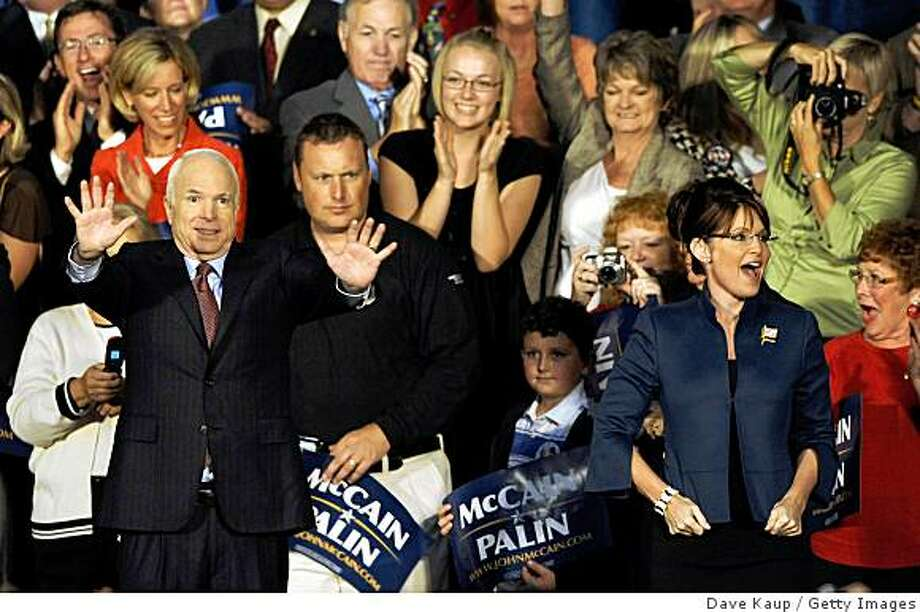 LEE'S SUMMIT, MO - SEPTEMBER 8:  Republican presidential nominee U.S. Sen. John McCain (R-AZ) (L) and vice-presidential nominee Alaska Gov. Sarah Palin greet supporters at a campaign rally at the John Knox Village retirement community September 8, 2008 in Lee's Summit, Missouri.  Sen. McCain is campaigning in the wake of the Republican National Convention (RNC) last week, where Gov. Palin was introduced as his running mate.  (Photo by Dave Kaup/Getty Images) Photo: Dave Kaup, Getty Images
